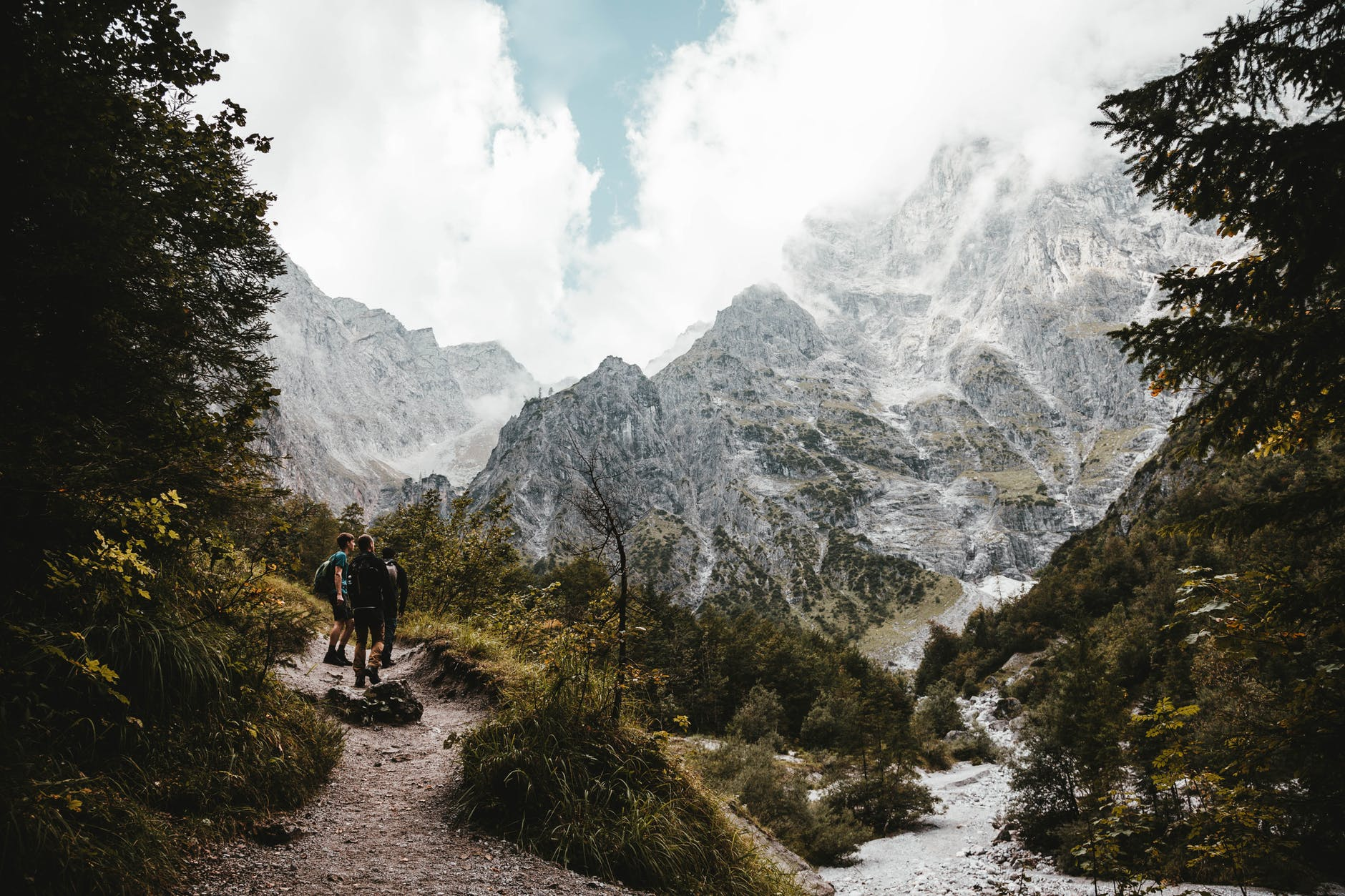 people hiking near mountains