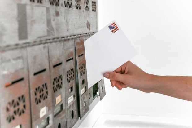 person holding white envelope