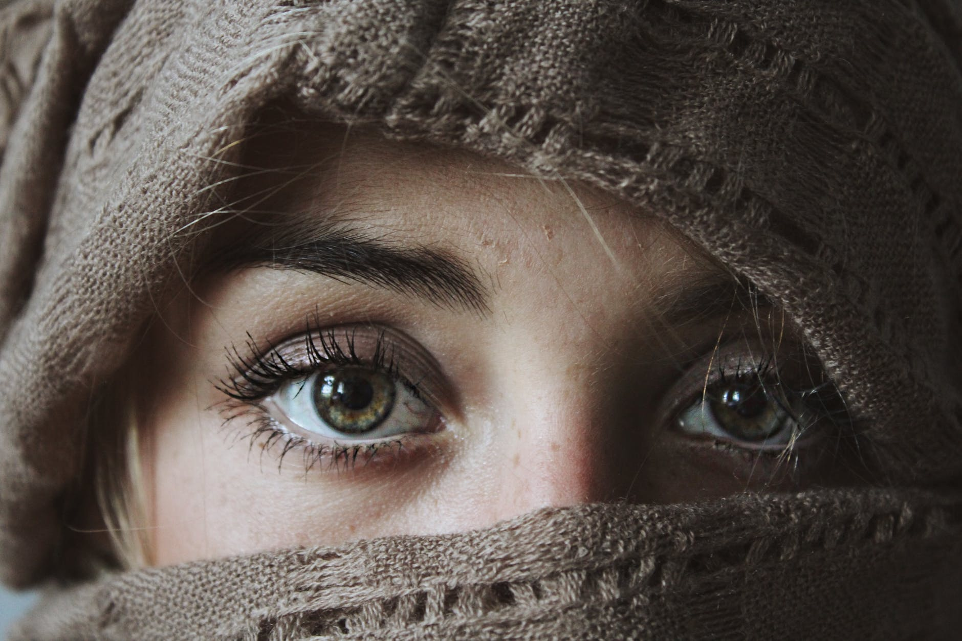 photo of person covered with brown textile