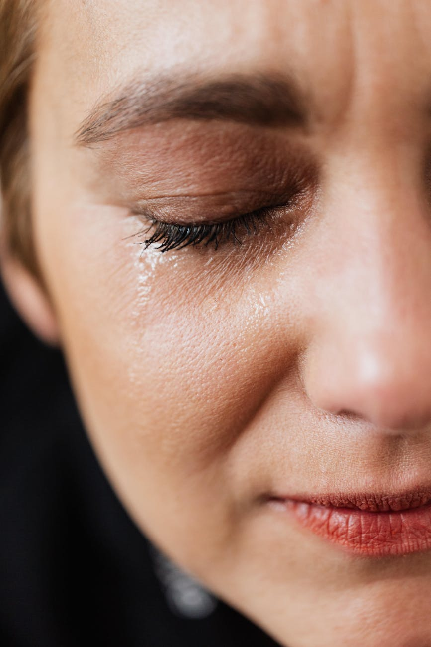 lonely woman crying with closed eyes